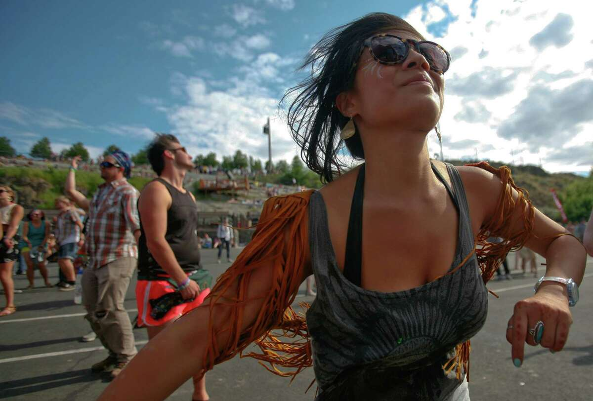 A concert attendee dances to Chiddy Bang during the Sasquatch Music Festival at the Gorge Amphitheatre in George, Wash., on Sunday, May 27, 2012.