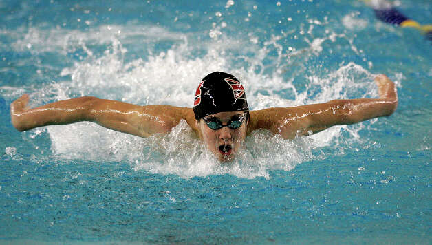 Churchill's Jimmy Feigen takes first in the boys' 100-yard butterfly as local swimmers put in big performances at the finals of the South Zone TISCA swim meet at the Davis Natatorium Saturday evening, Dec. 9, 2006. Photo: J. MICHAEL SHORT, For The Express-News / THE SAN ANTONIO EXPRESS-NEWS