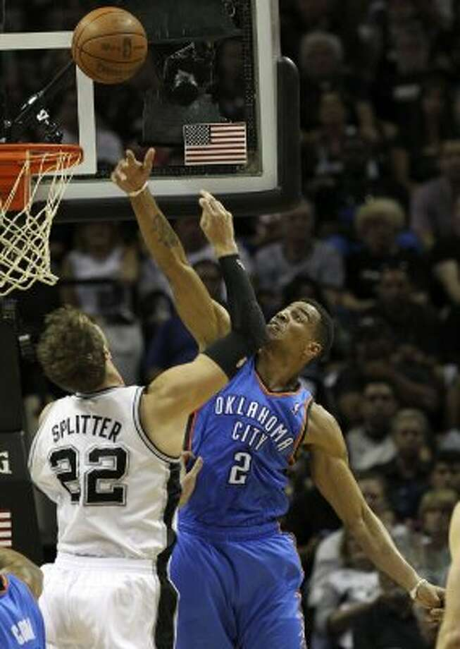 Oklahoma City Thunder's Thabo Sefolosha (2) blocks a shot by San Antonio Spurs' Tiago Splitter (22) during the first half of game one of the NBA Western Conference Finals in San Antonio, Texas on Sunday, May 27, 2012. (San Antonio Express-News)