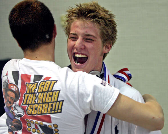 Jimmy Feigen screams as a teammate hugs him after Churchill won the UIL state swimming meet at the Jamail Texas Swimming Center in Austin on Feb. 23, 2008. Photo: TOM REEL, San Antonio Express-News / SAN ANTONIO EXPRESS-NEWS