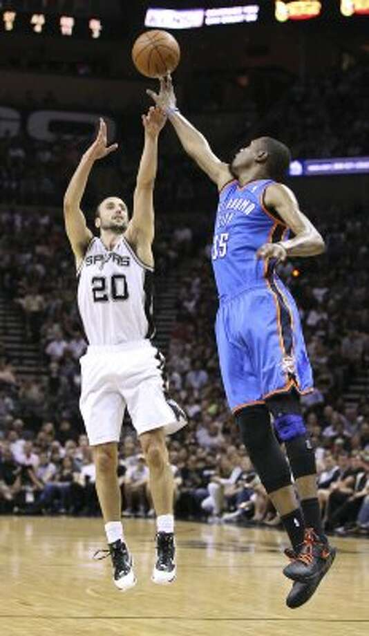 San Antonio Spurs' Manu Ginobili (20) shoots over Oklahoma City Thunder's Kevin Durant (35) during the first half of game one of the NBA Western Conference Finals in San Antonio, Texas, Sunday, May 27, 2012. (San Antonio Express-News)