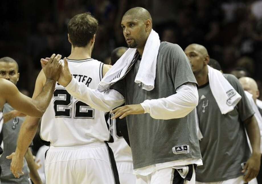 San Antonio Spurs' Tim Duncan (21) high fives San Antonio Spurs' Gary Neal (14) during the first half of game one of the NBA Western Conference Finals in San Antonio, Texas on Sunday, May 27, 2012. (San Antonio Express-News)