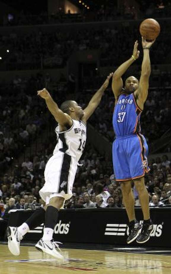 Oklahoma City Thunder's Derek Fisher (37) shoots over San Antonio Spurs' Gary Neal (14) during the first half of game one of the NBA Western Conference Finals in San Antonio, Texas on Sunday, May 27, 2012. (San Antonio Express-News)