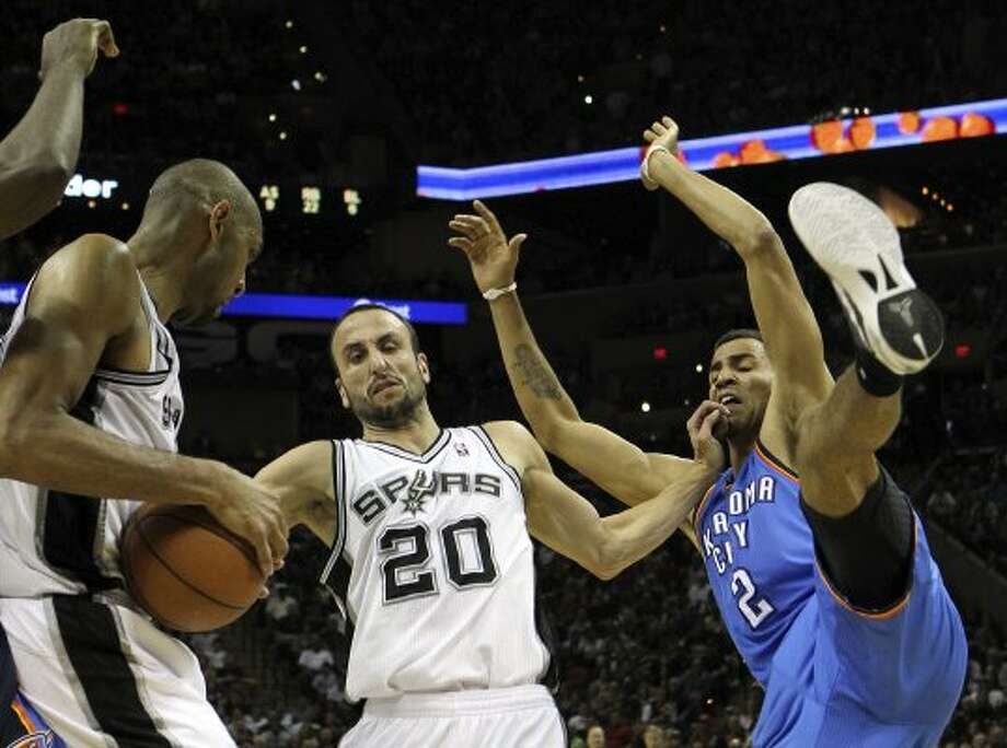 San Antonio Spurs' Tim Duncan (21), San Antonio Spurs' Manu Ginobili (20) and Oklahoma City Thunder's Thabo Sefolosha (2) contest a rebound during the first half of game one of the NBA Western Conference Finals in San Antonio, Texas on Sunday, May 27, 2012. (San Antonio Express-News)