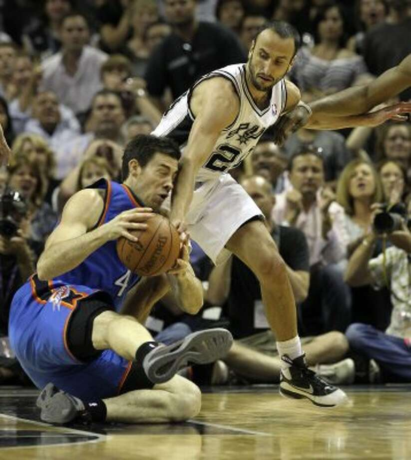 San Antonio Spurs' Manu Ginobili (20) goes for the ball against Oklahoma City Thunder's Nick Collison (4) during the first half of game one of the NBA Western Conference Finals in San Antonio, Texas on Sunday, May 27, 2012. (San Antonio Express-News)