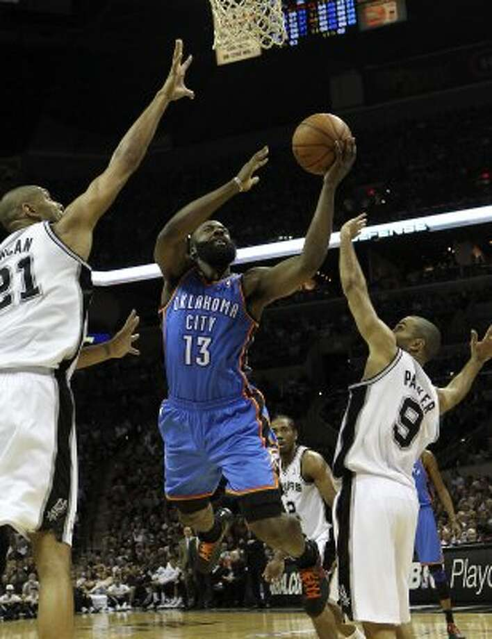 Oklahoma City Thunder's James Harden (13) shoots against San Antonio Spurs' Tim Duncan (21) and San Antonio Spurs' Tony Parker (9) during the first half of game one of the NBA Western Conference Finals in San Antonio, Texas on Sunday, May 27, 2012. (San Antonio Express-News)