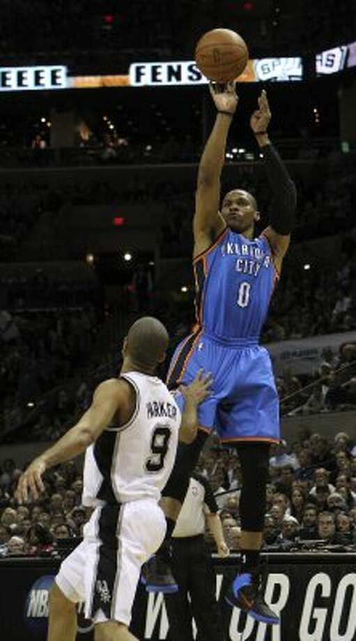 Oklahoma City Thunder's Russell Westbrook (0) shoots over San Antonio Spurs' Tony Parker (9) during the first half of game one of the NBA Western Conference Finals in San Antonio, Texas on Sunday, May 27, 2012. (San Antonio Express-News)