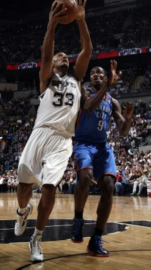 San Antonio Spurs' Boris Diaw (33) shoots over Oklahoma City Thunder's Serge Ibaka (9) during the first half of game one of the NBA Western Conference Finals in San Antonio, Texas, Sunday, May 27, 2012. (San Antonio Express-News)