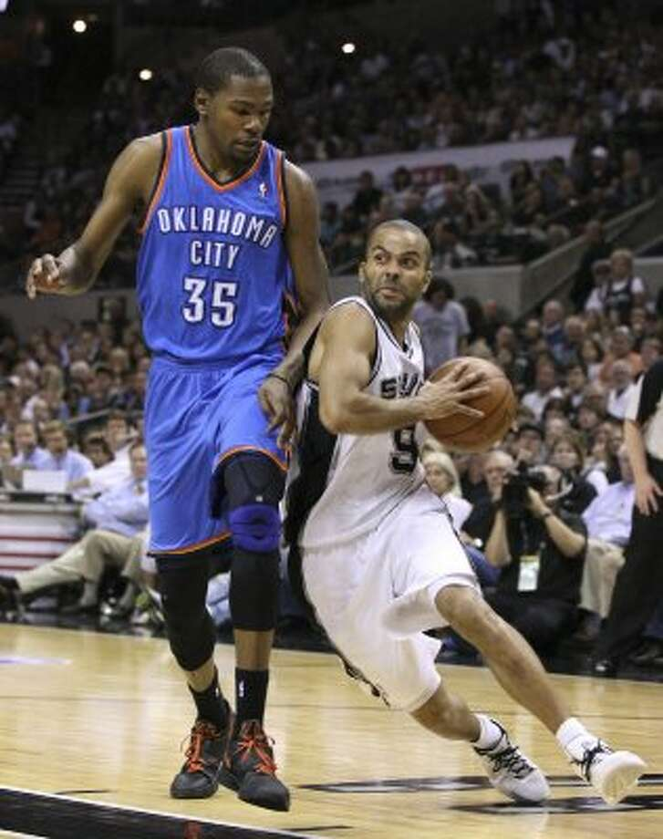 San Antonio Spurs' Tony Parker (9) drives against Oklahoma City Thunder's Kevin Durant (35) during the first half of game one of the NBA Western Conference Finals in San Antonio, Texas, Sunday, May 27, 2012. (San Antonio Express-News)