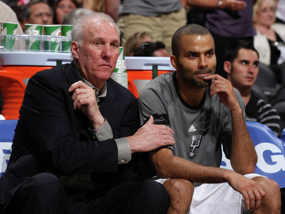 San Antonio Spurs coach Gregg Popovich sits with San Antonio Spurs' Tony Parker (9) during the second half of game one of the NBA Western Conference Finals in San Antonio, Texas, Sunday, May 27, 2012. Photo: Edward A. Ornelas, San Antonio Express-News / © 2012 San Antonio Express-News
