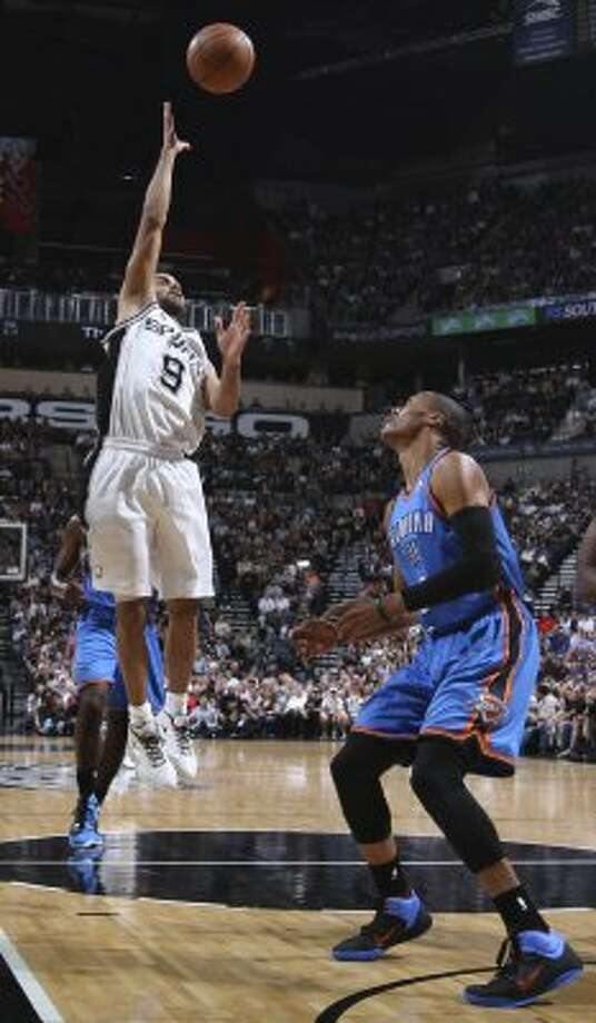 San Antonio Spurs' Tony Parker (9) shoots over Oklahoma City Thunder's Russell Westbrook (0) during the first half of game one of the NBA Western Conference Finals in San Antonio, Texas, Sunday, May 27, 2012. (San Antonio Express-News)