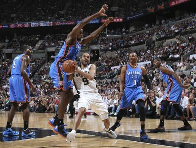 San Antonio Spurs' Tony Parker (9) goes to the basket against Oklahoma City Thunder's Serge Ibaka (9) and Kendrick Perkins (5), Russell Westbrook (0) and Kevin Durant (35) during the first half of game one of the NBA Western Conference Finals in San Antonio, Texas, Sunday, May 27, 2012. (San Antonio Express-News)