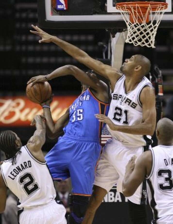 Oklahoma City Thunder's Kevin Durant (35) shoots against San Antonio Spurs' Kawhi Leonard (2) and San Antonio Spurs' Tim Duncan (21) during the first half of game one of the NBA Western Conference Finals in San Antonio, Texas, Sunday, May 27, 2012. (San Antonio Express-News)