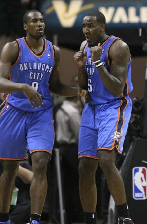 Oklahoma City Thunder's Kendrick Perkins (5) reacts next to Oklahoma City Thunder's Serge Ibaka (9) during the first half of game one of the NBA Western Conference Finals in San Antonio, Texas, Sunday, May 27, 2012. (San Antonio Express-News)