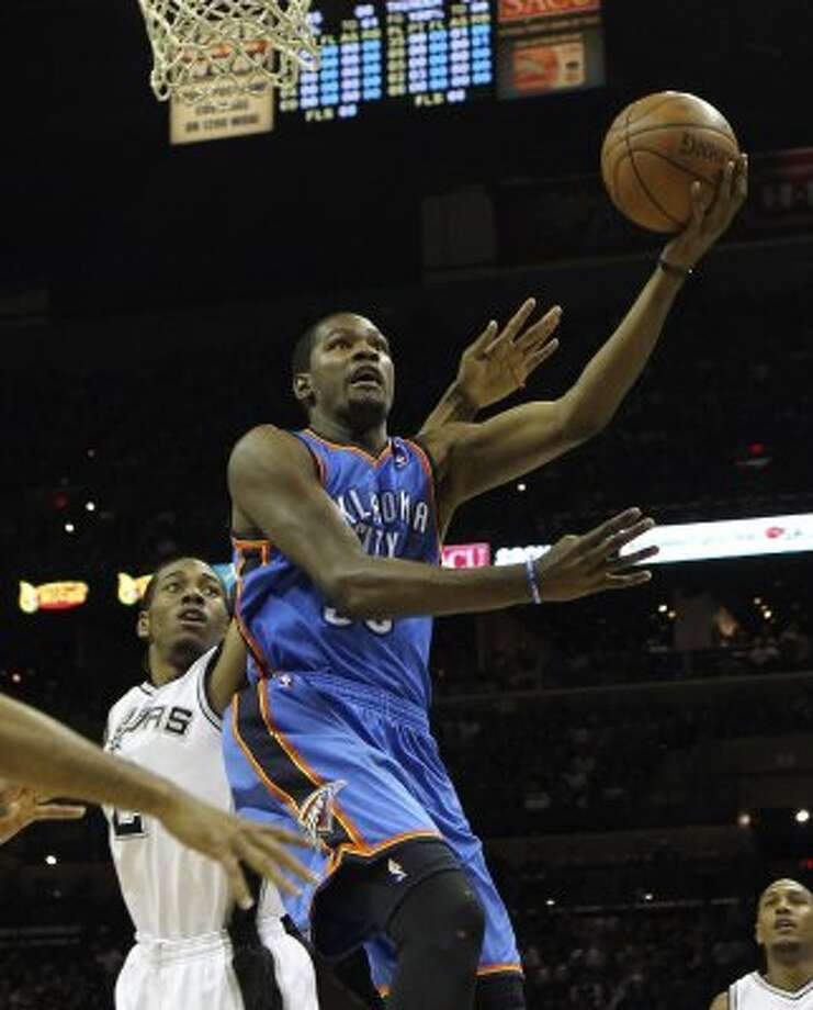 Oklahoma City Thunder's Kevin Durant (35) shoots past San Antonio Spurs' Kawhi Leonard (2) during the first half of game one of the NBA Western Conference Finals in San Antonio, Texas on Sunday, May 27, 2012. (San Antonio Express-News)