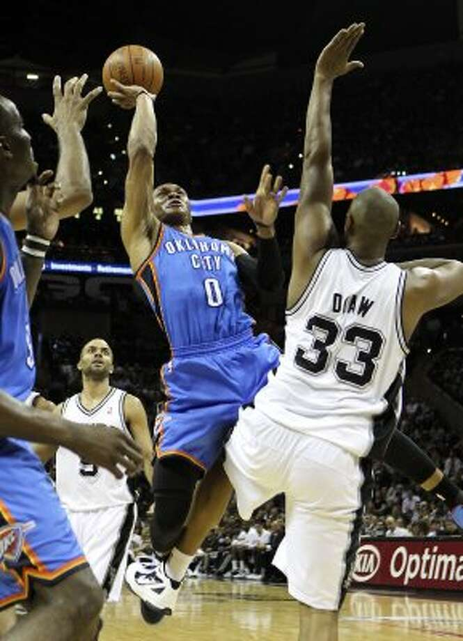 Oklahoma City Thunder's Russell Westbrook (0) shoots over s33/ during the first half of game one of the NBA Western Conference Finals in San Antonio, Texas on Sunday, May 27, 2012. (San Antonio Express-News)