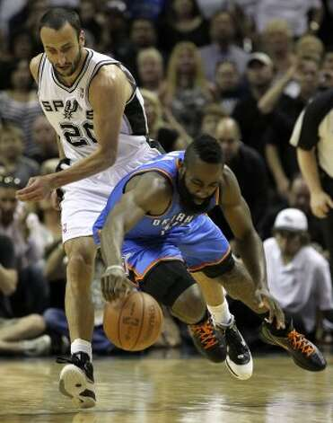 San Antonio Spurs' Manu Ginobili (20) goes for a loose ball against Oklahoma City Thunder's James Harden (13) during the first half of game one of the NBA Western Conference Finals in San Antonio, Texas on Sunday, May 27, 2012. (San Antonio Express-News)