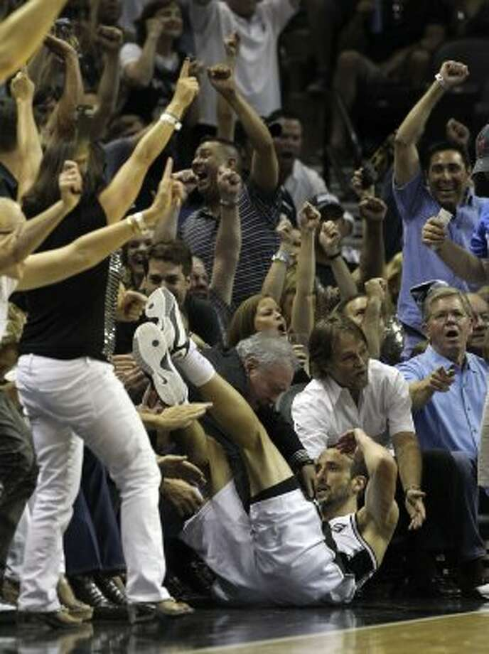 San Antonio Spurs' Manu Ginobili (20) falls out of bounds after hitting a three point basket during the first half of game one of the NBA Western Conference Finals in San Antonio, Texas on Sunday, May 27, 2012. (San Antonio Express-News)