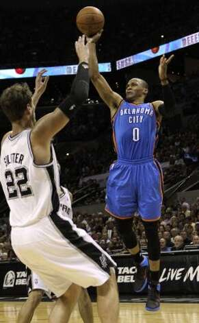 Oklahoma City Thunder's Russell Westbrook (0) shoots over San Antonio Spurs' Tiago Splitter (22) during the first half of game one of the NBA Western Conference Finals in San Antonio, Texas on Sunday, May 27, 2012. (San Antonio Express-News)
