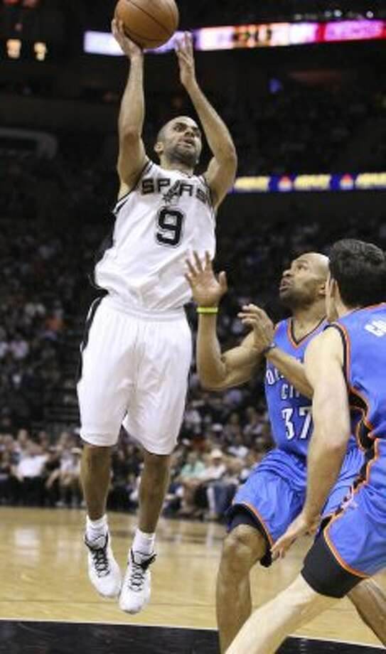 San Antonio Spurs' Tony Parker (9) shoots against Oklahoma City Thunder's Derek Fisher (37) and Oklahoma City Thunder's Nick Collison (4) during the first half of game one of the NBA Western Conference Finals in San Antonio, Texas, Sunday, May 27, 2012. (San Antonio Express-News)