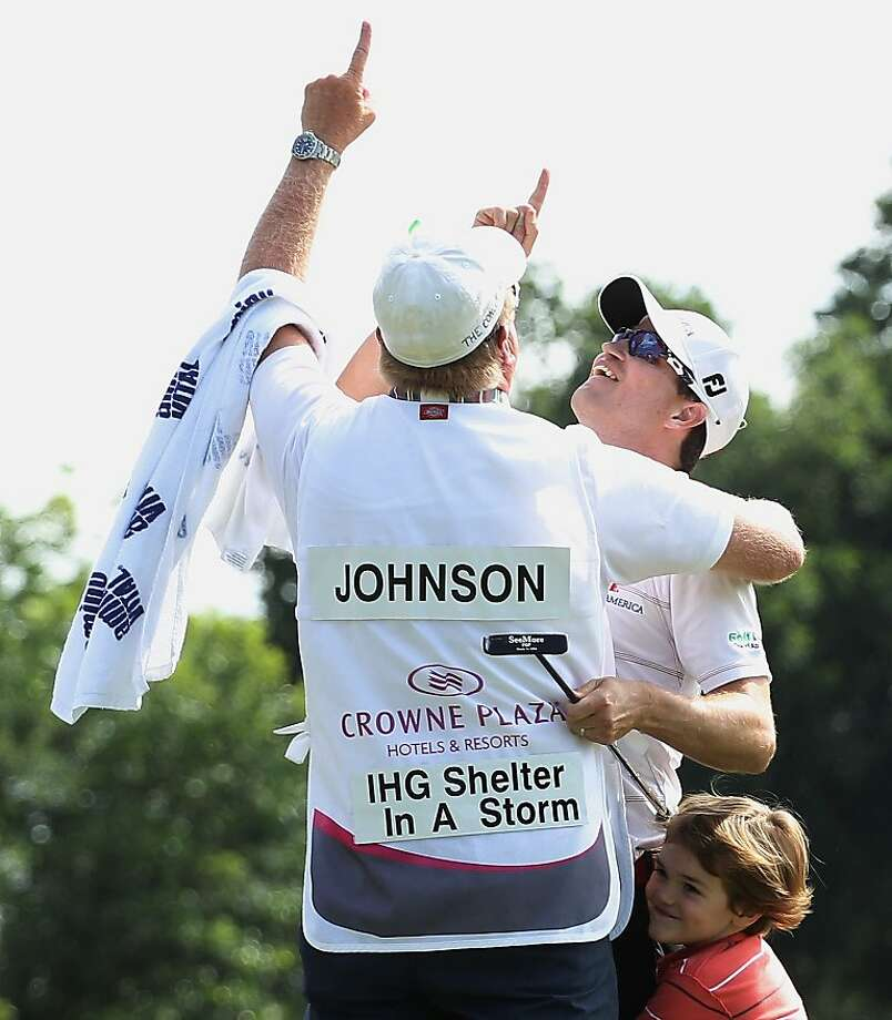 FORT WORTH, TX - MAY 27:  Zach Johnson celebrates on the 18th green with his caddie Damon Green and son Will after his one-stroke victory after the final round of the Crowne Plaza Invitational at Colonial at the Colonial Country Club on May 27, 2012 in Fort Worth, Texas.  (Photo by Scott Halleran/Getty Images) Photo: Scott Halleran, Getty Images