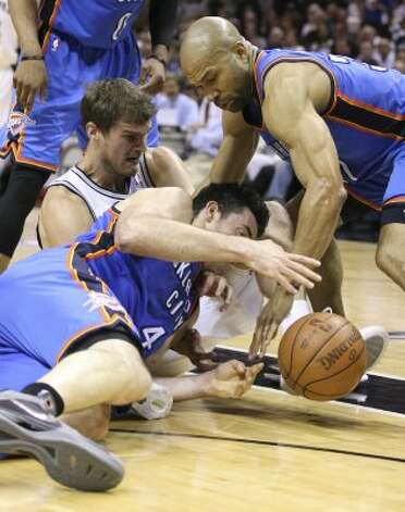 San Antonio Spurs' Tiago Splitter (22) goes for a loose ball against Oklahoma City Thunder's Nick Collison (4) and Oklahoma City Thunder's Derek Fisher (37) during the first half of game one of the NBA Western Conference Finals in San Antonio, Texas, Sunday, May 27, 2012. (San Antonio Express-News)