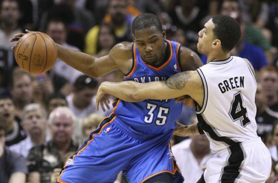 Oklahoma City Thunder's Kevin Durant (35) dribbles against San Antonio Spurs' Danny Green (4) during the first half of game one of the NBA Western Conference Finals in San Antonio, Texas, Sunday, May 27, 2012. (San Antonio Express-News)