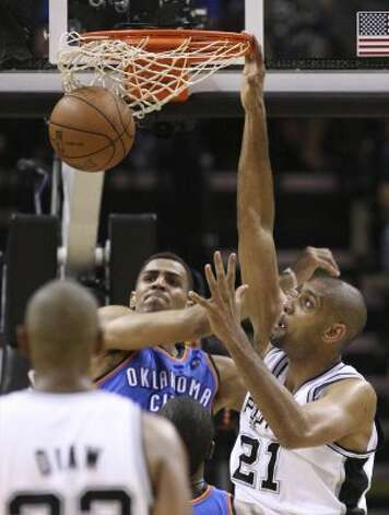 San Antonio Spurs' Tim Duncan (21) dunks on Oklahoma City Thunder's Thabo Sefolosha (2) during the second half of game one of the NBA Western Conference Finals in San Antonio, Texas, Sunday, May 27, 2012. (San Antonio Express-News)