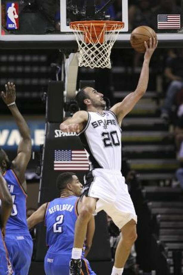 San Antonio Spurs' Manu Ginobili (20) lays the ball in during the second half of game one of the NBA Western Conference Finals in San Antonio, Texas, Sunday, May 27, 2012. (San Antonio Express-News)