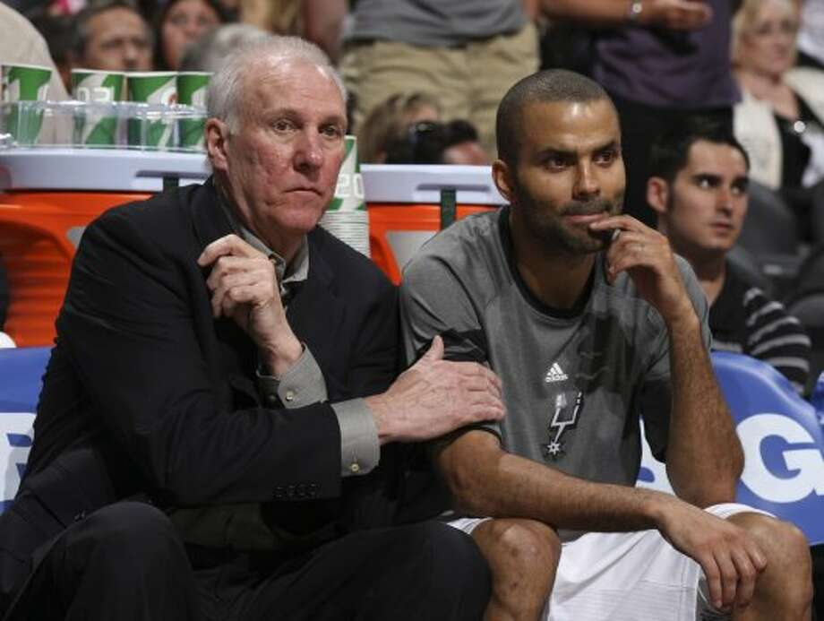 San Antonio Spurs coach Gregg Popovich sits with San Antonio Spurs' Tony Parker (9) during the second half of game one of the NBA Western Conference Finals in San Antonio, Texas, Sunday, May 27, 2012. (San Antonio Express-News)