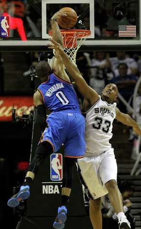 Oklahoma City Thunder's Russell Westbrook (0) attempts a dunk against San Antonio Spurs' Boris Diaw (33) during the second half of game one of the NBA Western Conference Finals in San Antonio, Texas on Sunday, May 27, 2012. Photo: Kin Man Hui, San Antonio Express-News / © 2012 San Antonio Express-News