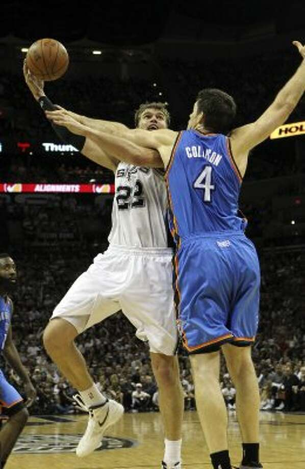 San Antonio Spurs' Tiago Splitter (22) shoots over Oklahoma City Thunder's Nick Collison (4) during the second half of game one of the NBA Western Conference Finals in San Antonio, Texas on Sunday, May 27, 2012. (San Antonio Express-News)