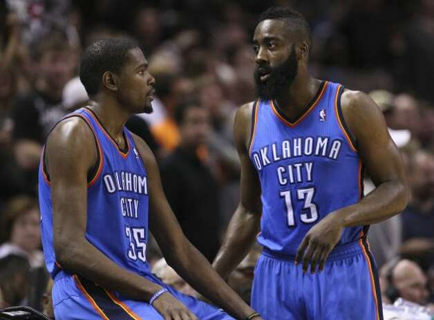 Oklahoma City Thunder's Kevin Durant (35) talks to Oklahoma City Thunder's James Harden (13) during the second half of game one of the NBA Western Conference Finals in San Antonio, Texas, Sunday, May 27, 2012. (San Antonio Express-News)