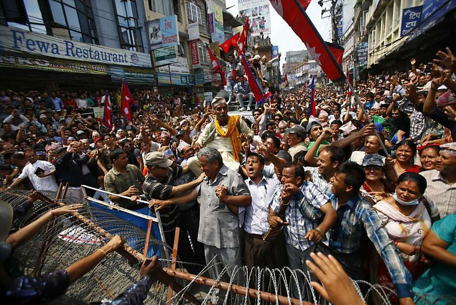 Nepal's Brahmins and Chhetri society members hold a demonstration near the Constitution Assembly building in Katmandu, Nepal, Sunday, May 27, 2012. They demanded that states proposed in the new constitution should not be determined on the basis of ethnicity. (AP Photo/Niranjan Shrestha) Photo: Niranjan Shrestha, Associated Press