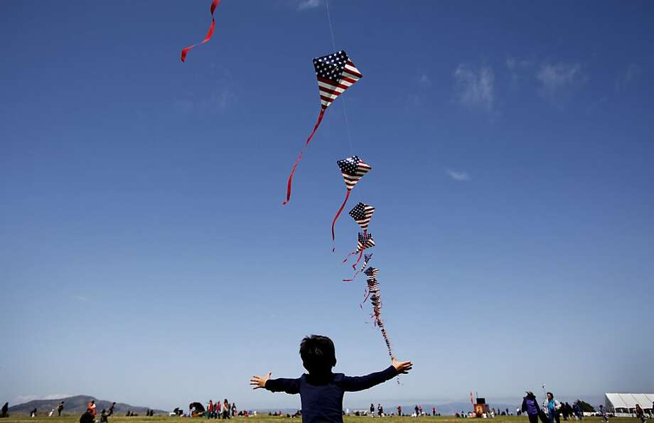 Joseph Kearns, 4, of San Francisco, tries to reach a kite flying in Crissy Field for the celebration of the 75th anniversary of the Golden Gate Bridge in San Francisco, Calif. Sunday, May 27, 2012. Photo: Sarah Rice, Special To The Chronicle
