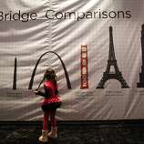 Marisa Miyaki, 5, of San Francisco, checks out one of the informational displays inside the Bridge History Tent during the celebration of the 75th anniversary of the Golden Gate Bridge at Crissy Field in San Francisco, Calif. Sunday, May 27, 2012.