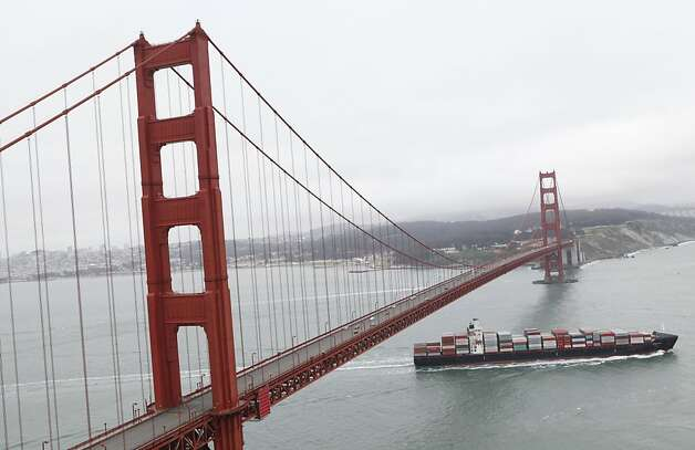 A tanker is seen passing through under the Golden Gate Bridge on May 27, 2012 in California.  The Golden Gate Bridge celebrates its 75th Anniversary on May 27.  San Francisco on Sunday marked the 75th anniversary of the Golden Gate Bridge, the distinctive orange vermilion structure that attracts some 10 million visitors each year.       AFP Photo / Kimihiro HoshinoKIMIHIRO HOSHINO/AFP/GettyImages Photo: Kimihiro Hoshino, AFP/Getty Images