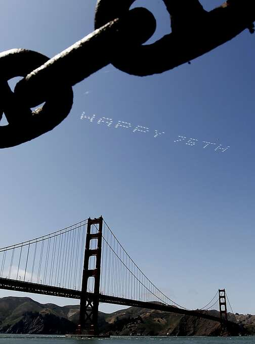 Birthday wishes take to the sky for the Golden Gate Bridge. Festivities for the bridge's 75th stretched from Fort Point to the Marina Green. Photo: Michael Macor, The Chronicle