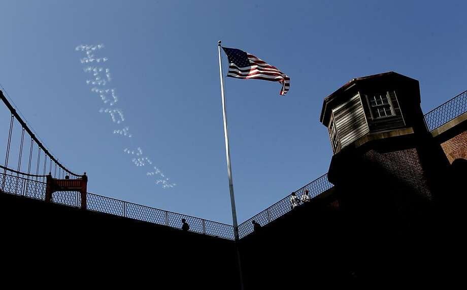 Fort Point with skywriting high above, during the 75th anniversary celebration of the Golden Gate Bridge along Crissy Field, on Sunday May 27, 2012, in San Francisco, Ca. Photo: Michael Macor, The Chronicle
