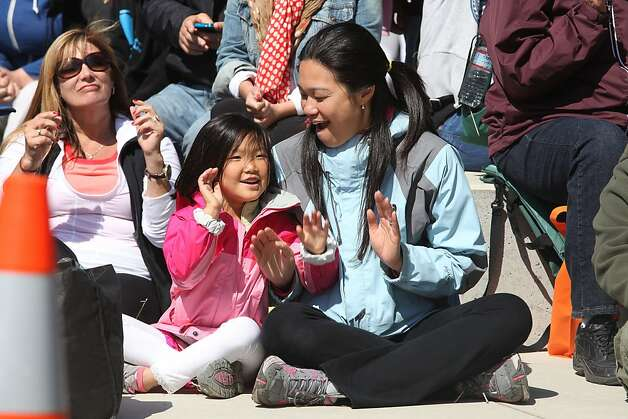 Kylie Choi (left) and her mother Camille Tsao (right) enjoy listening to singing group Chilled On at east Crissy Field in San Francisco, California, on Sunday, May 27, 2012, during the Golden Gate Bridge 75th anniversary. Photo: Liz Hafalia, The Chronicle