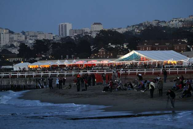 Crowds line up on the beach to watch the fireworks during the 75th anniversary of the Golden Gate Bridge in San Francisco, Calif. Sunday, May 27, 2012. Photo: Sarah Rice, Special To The Chronicle