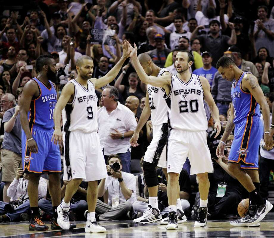 San Antonio Spurs point guard Tony Parker (9), of France, and Manu Ginobili (20) celebrate in front of Oklahoma City Thunder guard James Harden, left, and Thabo Sefolosha, right, during the second half of Game 1 in their NBA basketball Western Conference finals playoff series, Sunday, May 27, 2012, in San Antonio. San Antonio won 101-98. (AP Photo/Eric Gay) Photo: Eric Gay, Associated Press / AP