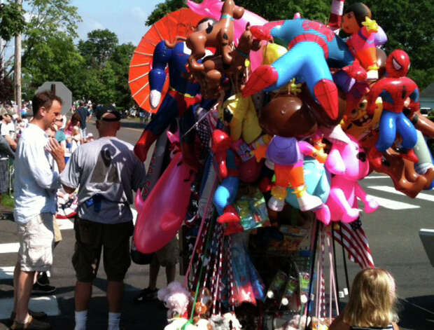 Vendors selling colorful balloons and momentos lined the route Monday morning of Fairfield's Memorial Day parade. Photo: Andrew Brophy / Fairfield Citizen contributed