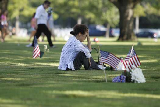 Jue Yon Bolt mourns at the gravesite of her husband, richard bolt Jr, who was a Vietnam army veteran, who passed away last June at the Houston national cemetery, Monday, May 28, 2012. Photo: Karen Warren, Houston Chronicle