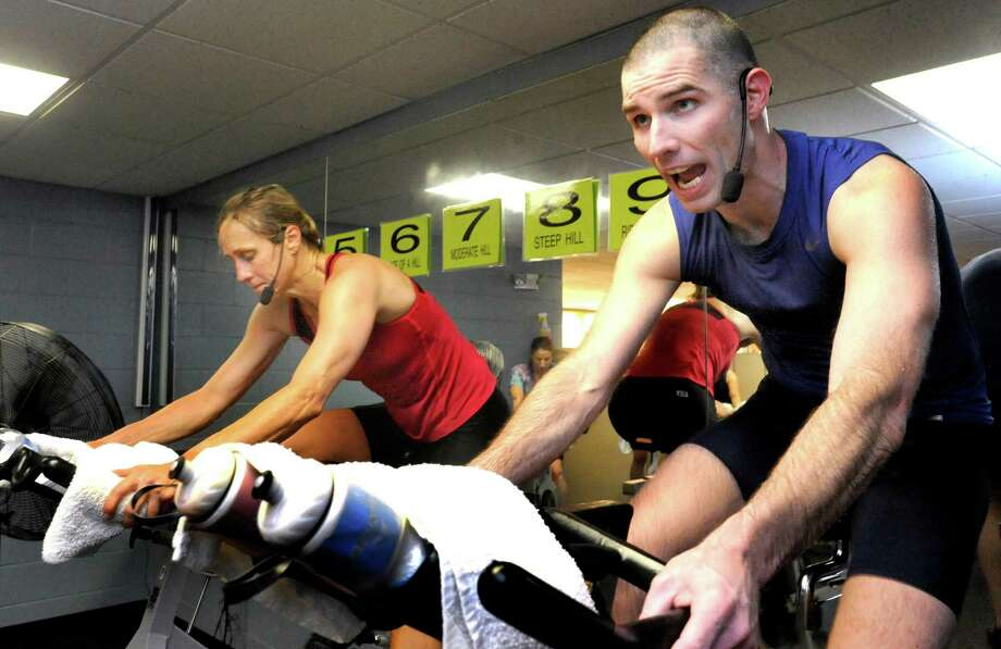 Vicki Donohoe and Brian McCambley lead a Memorial Day Cyclathon at the Greenknoll YMCA in Brookfield Monday, May 28, 2012. Photo: Michael Duffy