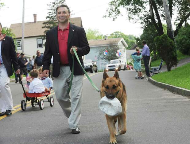 State Rep. Fred Camillo walk with his dog at the Ninth District Veterans Association's Memorial Day Parade in Glenville Sunday, May 27, 2012. Photo: Helen Neafsey / Greenwich Time