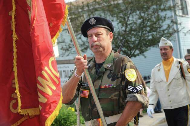 Veteran John Gawans carries the Ninth Diestrict Veterans Association flag during the  Association's Memorial Day Parade in Glenville Sunday, May 27, 2012. Photo: Helen Neafsey / Greenwich Time