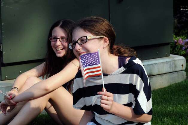 Jennifer Ruscigno, and her sister Rachel, both 12, wait for the Ninth District Veterans Association's Memorial Day Parade in Glenville Sunday, May 27, 2012. Photo: Helen Neafsey / Greenwich Time