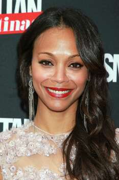 """In this May 9, 2012 photo, actress Zoe Saldana poses at the launch party for """"Cosmopolitan for Latinas,"""" magazine, at The Press Lounge in New York. The bi-annual magazine is targeted at English-speaking Latinas and is edited by and written for modern Hispanic women. Saldana graces the cover of the inaugural issue. Photo: AP"""
