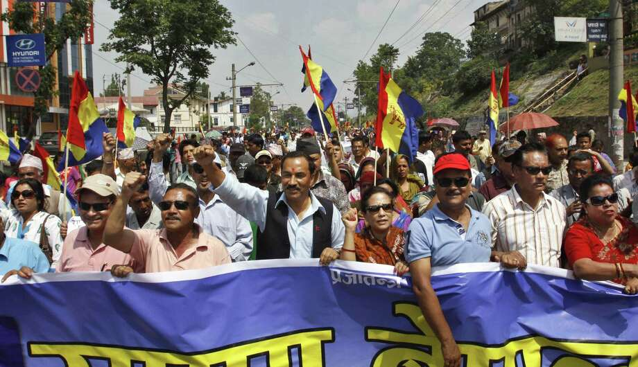 Supporters of pro-monarchy Rastriya Prajatantra Party take out a rally demanding that Nepal be declared a Hindu nation in Katmandu, Nepal, Monday, May 28, 2012. Nepal sank into political turmoil Monday after lawmakers failed to agree on a new constitution, leaving the country with no legal government. (AP Photo/Binod Joshi) Photo: Binod Joshi, Associated Press / AP